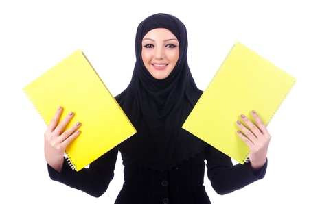 Young muslim woman with book on white photo