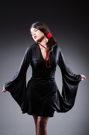Young attractive woman dancing flamenco photo