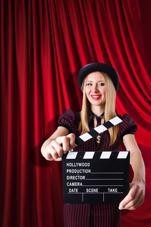 Woman gangster with movie clapper photo