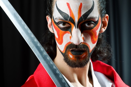 Man with sword and face mask Stock Photo - 21086882