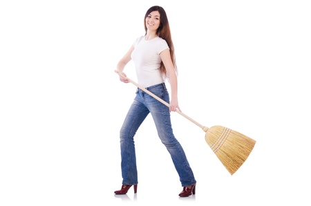 Young woman with broom isolated on white Stock Photo - 21077835