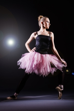 Ballerina dancing in the dark studio Stock Photo - 21110343
