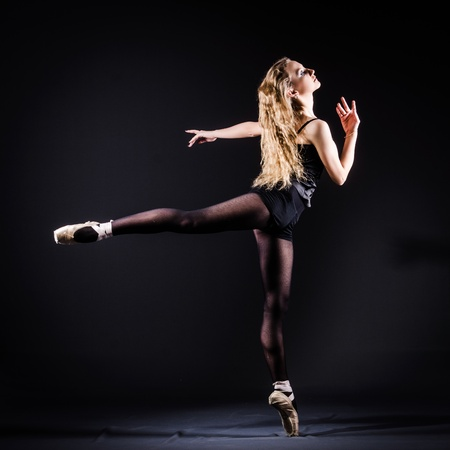 Ballerina dancing in the dark studio Stock Photo - 21110349
