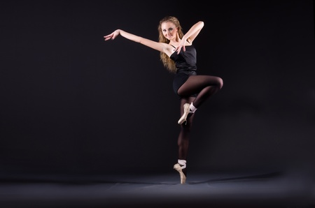 Ballerina dancing in the dark studio Stock Photo - 22266597