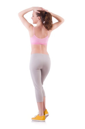 Young woman doing exercises on white Stock Photo - 21086996