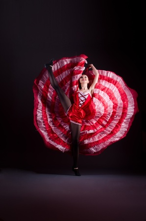 Girl in red dress dancing dance Stock Photo - 21110363