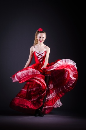 spanish girl: Girl in red dress dancing dance Stock Photo