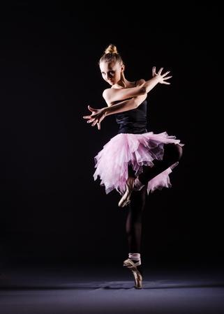 Ballerina dancing in the dark studio Stock Photo - 21110426