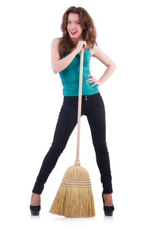 Young woman with broom isolated on white Stock Photo - 21087006