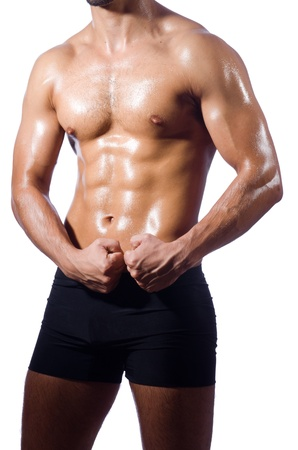 Muscular man isolated on the white Stock Photo - 20682224