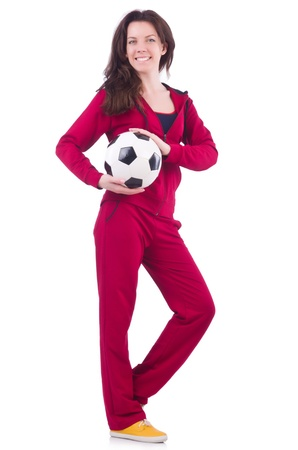 Young woman with football on white photo