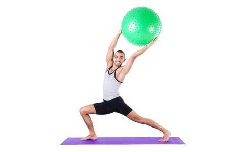 Man with swiss ball doing exercises on white Stock Photo - 21087101