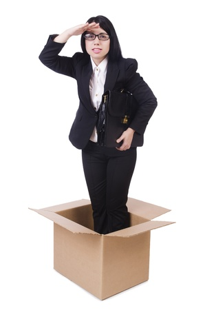 Businesswoman in thinking out of box concept photo