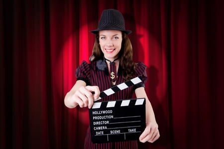 Woman gangster with movie clapper Stock Photo - 21085424