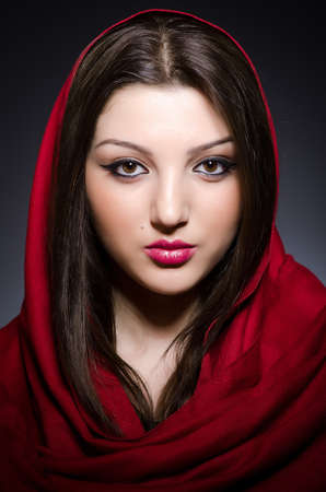 Muslim woman with headscarf in fashion concept photo