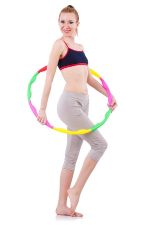 Woman doing exercises with hula hoop Stock Photo - 21110564