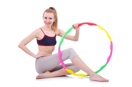 Woman doing exercises with hula hoop photo