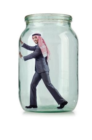 Arab businessman in glass jar photo