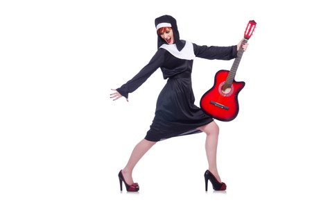 Nun playing guitar isolated on white photo