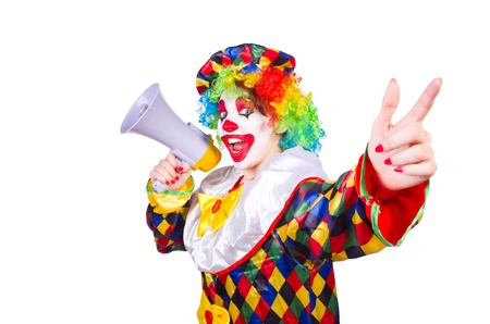 Clown with loudspeaker on white photo