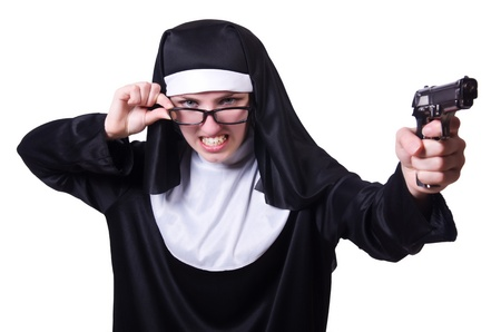 Nun with handgun isolated on white Stock Photo - 21077090