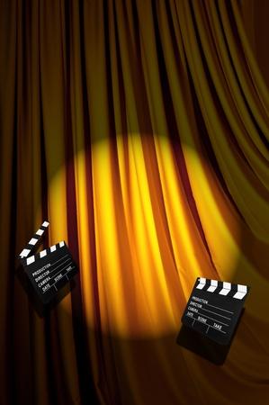 Movie clapper board against curtain Stock Photo - 20838797