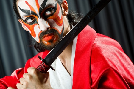Man with sword and face mask Stock Photo - 21084355