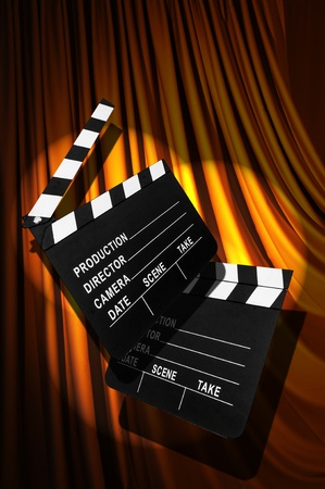 Movie clapper board against curtain Stock Photo - 20838827