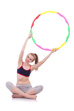 Woman doing exercises with hula hoop Stock Photo - 21084505