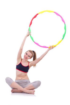 Woman doing exercises with hula hoop Stock Photo - 21084505