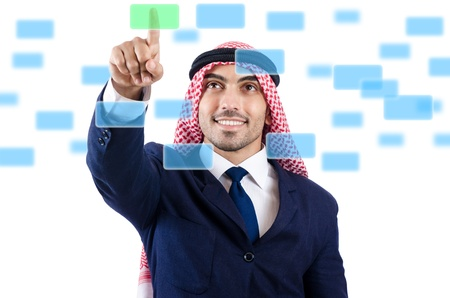 Arab man pressing virtual buttons photo