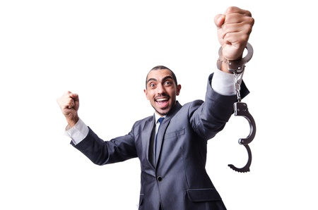 Funny businessman with handcuffs on white photo