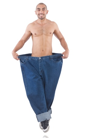 Man in dieting concept with oversized jeans Stock Photo - 21326994