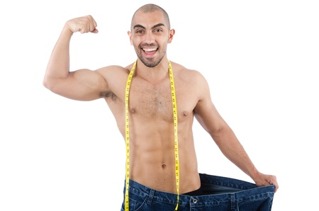 Man in dieting concept with oversized jeans Stock Photo - 21326995