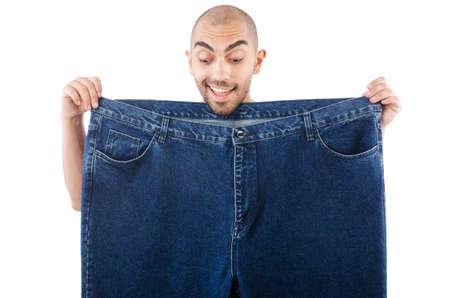 Der Mensch in der Diät-Konzept mit übergroßen Jeans