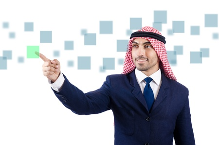 Arab man pressing virtual buttons Stock Photo - 21327072