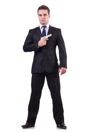 man holding gun: Businessman with gun isolated on white