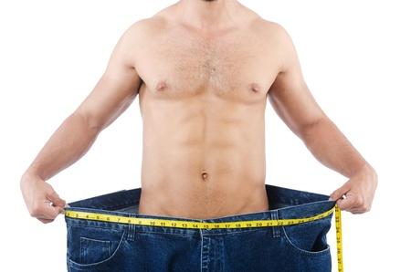 przewymiarowany: Człowiek w koncepcji diety z przewymiarowany jeansy Zdjęcie Seryjne