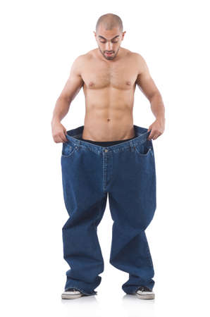 lose: Man in dieting concept with oversized jeans