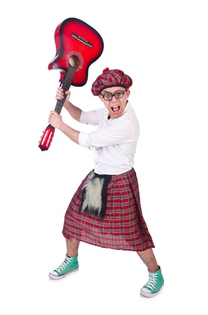 Funny scotsman with guitar on white photo