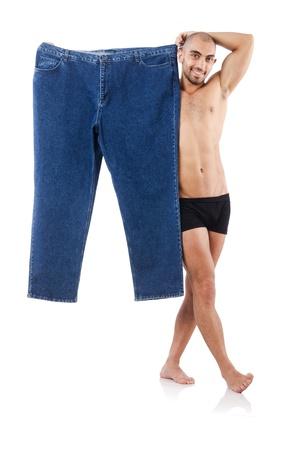 przewymiarowany: Man in dieting concept with oversized jeans