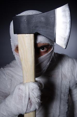 hatchet man: Mummy with axe in halloween concept