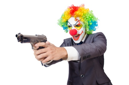 Businessman clown with gun isolated on white photo