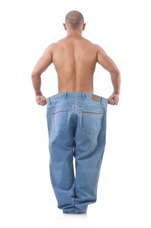 hombre flaco: Hombre en concepto de dieta con los pantalones vaqueros de gran tama�o