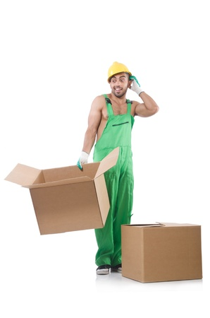 Man in green coveralls with boxes photo