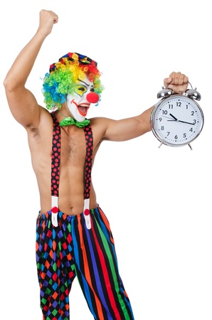Clown with alarm clock on white photo