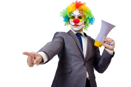 Businessman clown with loudspeaker on white photo