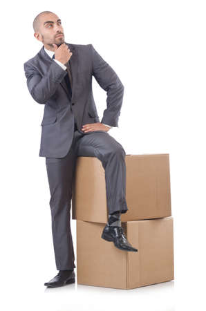 Businessman with box isolated on the white Stock Photo - 21792507