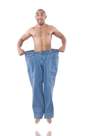 Man in dieting concept with oversized jeans photo