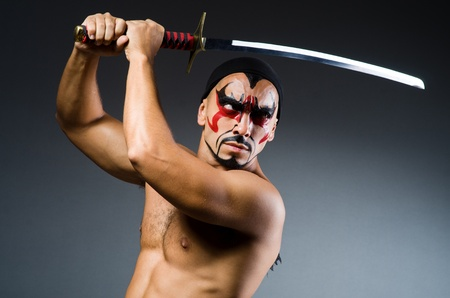 Man with sword and face paint Stock Photo - 22113828